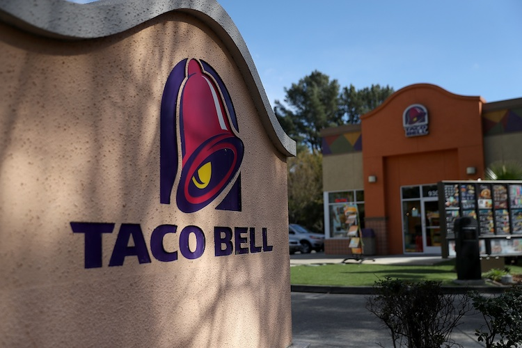 NOVATO, CA - FEBRUARY 22:  A sign is posted in front of a Taco Bell restaurant on February 22, 2018 in Novato, California. Taco Bell has become the fourth-largest domestic restaurant brand by edging out Burger King. Taco Bell sits behind the top three restaurant chains McDonald's, Starbucks and Subway.  (Photo by Justin Sullivan/Getty Images)