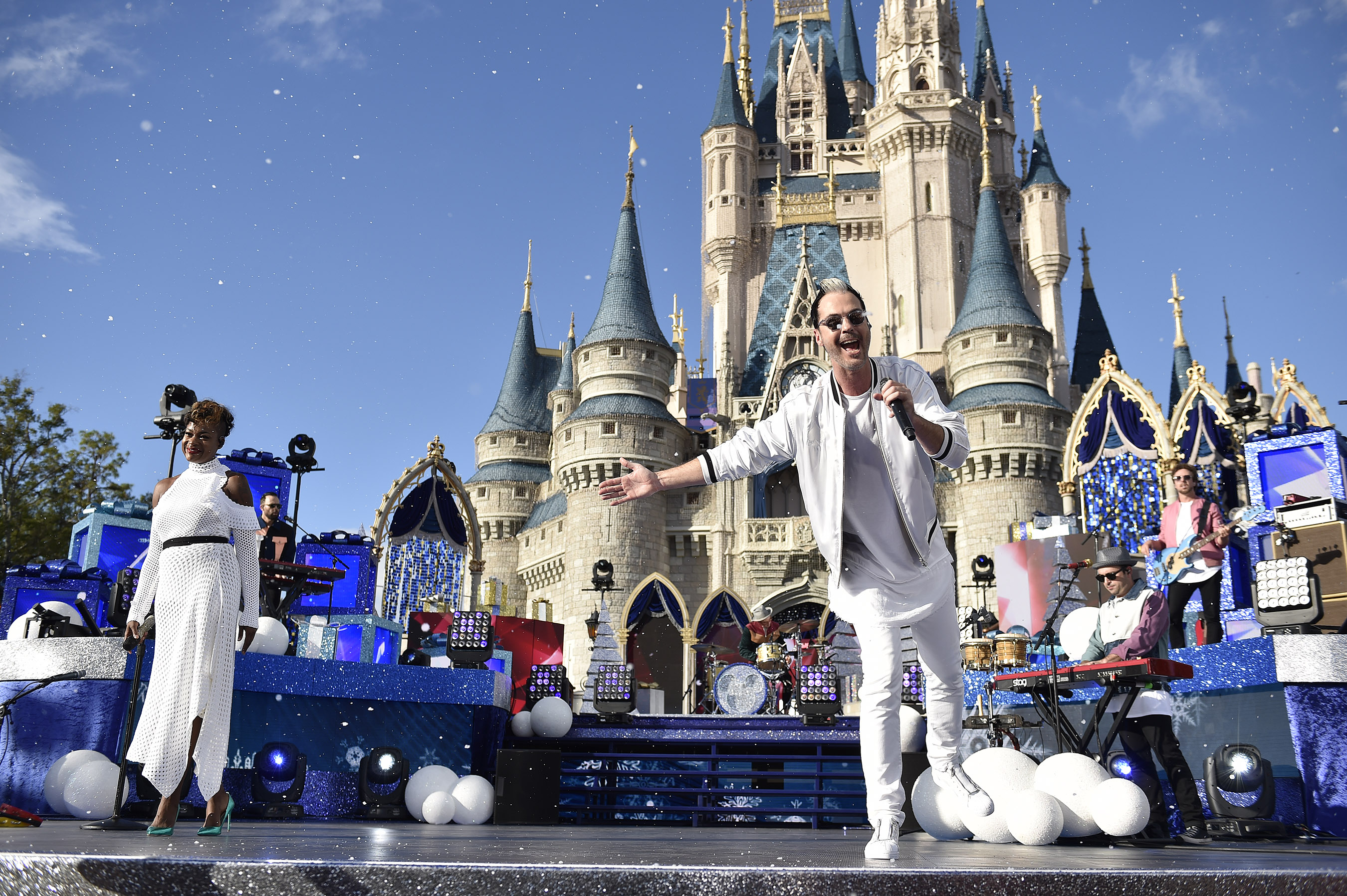 """LAKE BUENA VISTA, FL - NOVEMBER 05:  Fitz and the Tantrums perform """"Last Christmas"""" at Magic Kingdom Park in Lake Buena Vista Fla., November 5, 2017, during a taping of """"Disney Parks Magical Christmas Celebration."""" The star-studded Christmas special, featuring performances from Walt Disney World Resort in Florida and Disneyland Resort in California, premieres December 25, 10a.m.-11a.m. EST, on The ABC Television Network.  (Photo by Mark Ashman/Disney Parks via Getty Images)"""