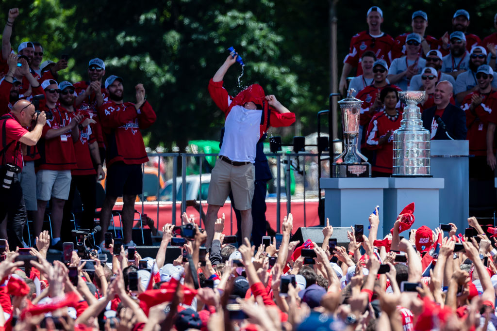 WASHINGTON, DC - JUNE 12: T.J. Oshie #77 of the Washington Capitals drinks a beer through his jersey during the Washington Capitals Victory Parade and Rally on June 12, 2018 in Washington, DC.  (Photo by Scott Taetsch/Getty Images)
