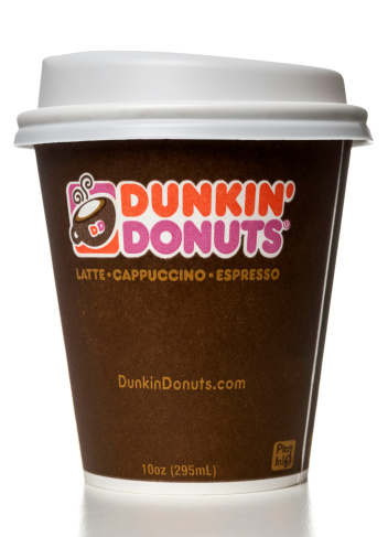 Miami, USA - October 12, 2013: Dunkin' Donuts latte capuccino espresso 10 OZ cup. Dunkin' Donuts brand is owned by DD IP Holder LLC.